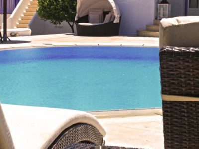 Look of the pool featuring a variety of garden furniture