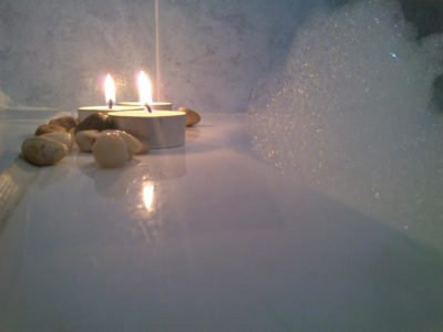 Close look of the bathtub featuring decoration and soap bubbles giving a sense of relaxation